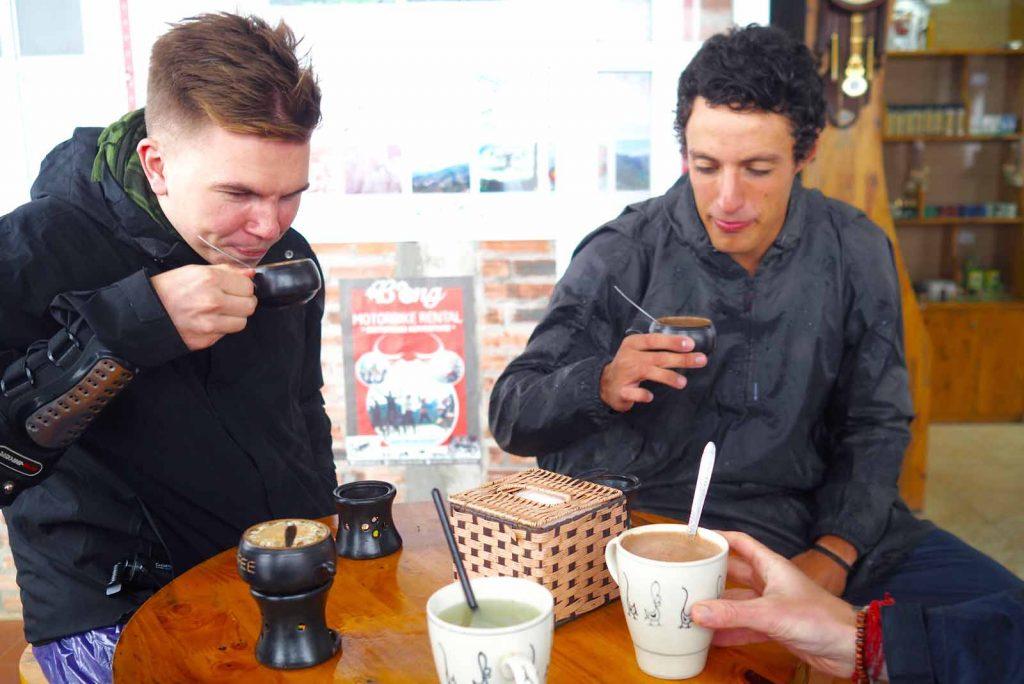 2 travelers drink coffee in my 3 day ha giang loop tour